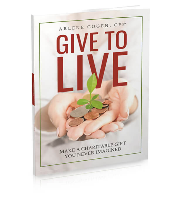 The cover of the Give to LIVE book. A pile of coins in someone's hands are sprouting a plant.